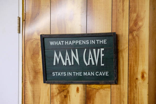 Handmade Wedding Sign Man Cave sign says that what happens in the mancave stays there. man cave stock pictures, royalty-free photos & images
