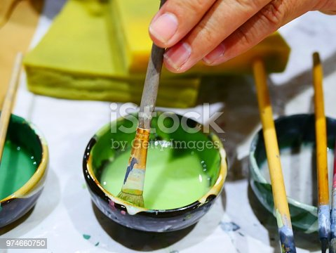 627000458istockphoto Handmade with paints a ceramic 974660750