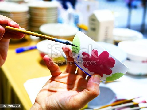 627000458istockphoto Handmade with paints a ceramic 974660770