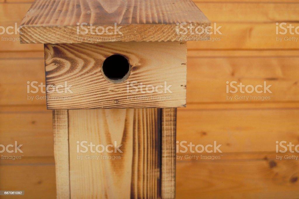 A handmade wooden birdhouse stock photo