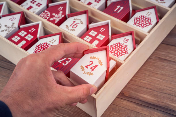 Handmade wooden perpetual calendar in a form of a house stock photo