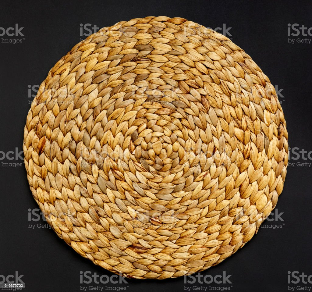Handmade woven straw table mat stock photo