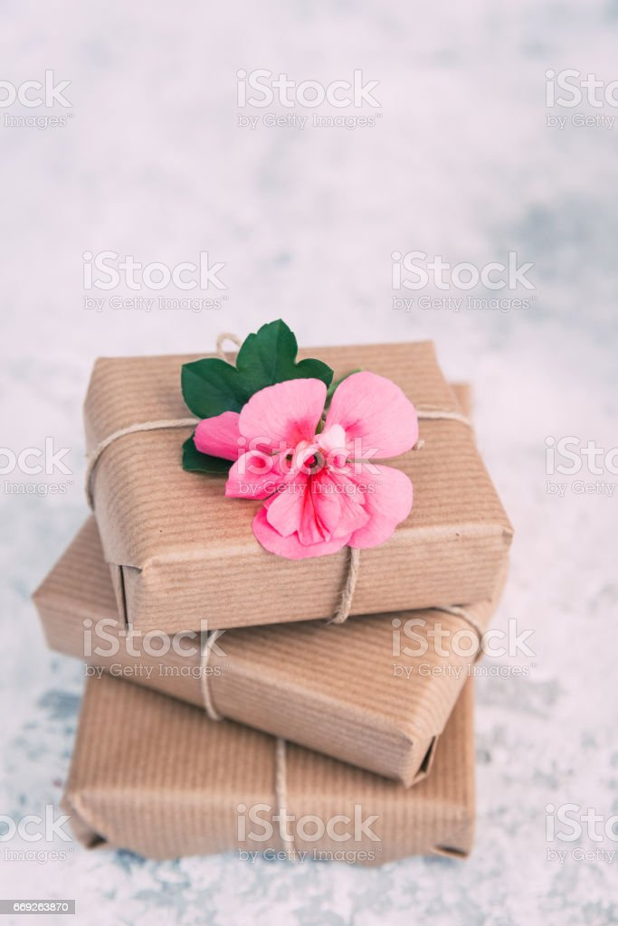 Handmade wrapped gift boxes with flowers. Present for mothers day