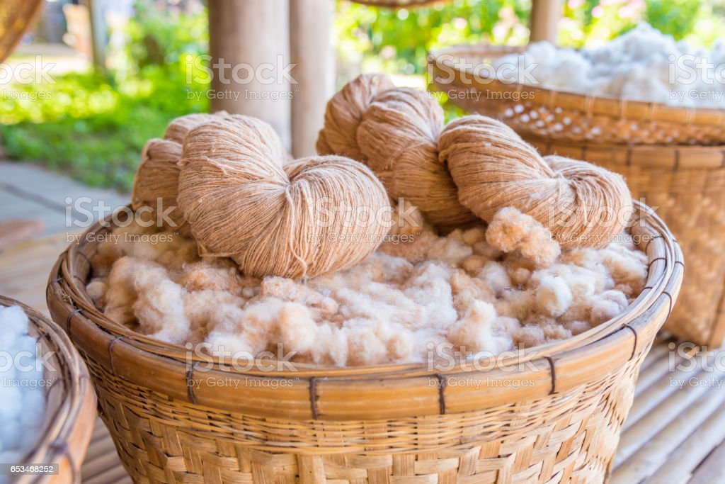 Handmade yarn from the cotton flower stock photo