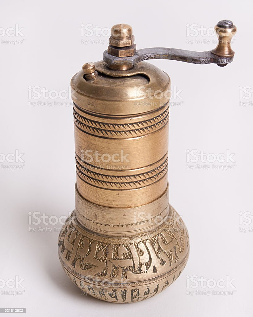 Hand-mill for spices on a white background stock photo