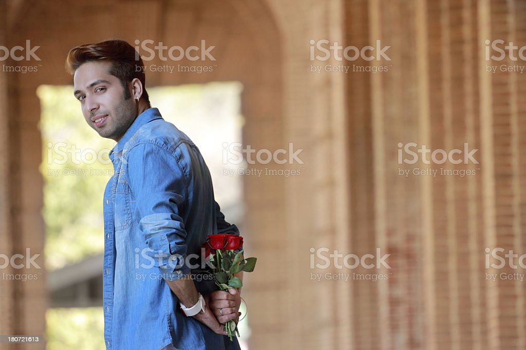handosme young man with red rose royalty-free stock photo