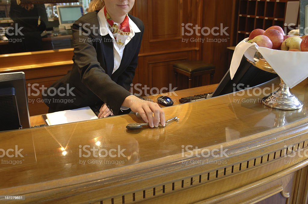 Hand-over of keys in a hotel royalty-free stock photo