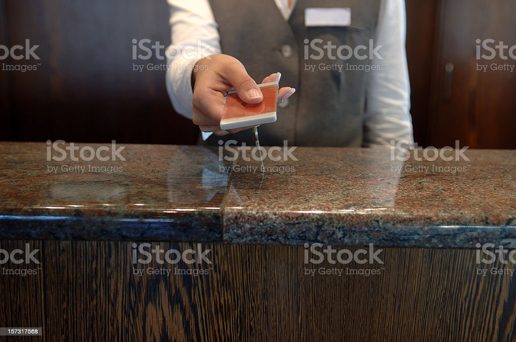 Hand-over of keys in a hotel stock photo