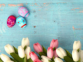 Hand-painted easter eggs with tulips