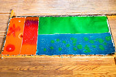 handpainted fabric in batik technique on frame