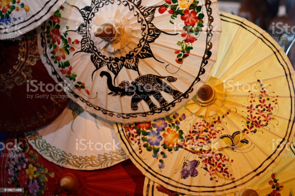 handpainted fabric umbrellas for sale at a night market in Chiang Mai, Northern Thailand, Southeast Asia stock photo