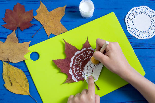 Hand-painted on dry autumn leaves stock photo