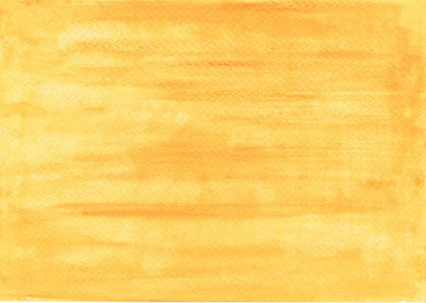 Handpainted simple watercolor wash background in yellow and orange color stock photo