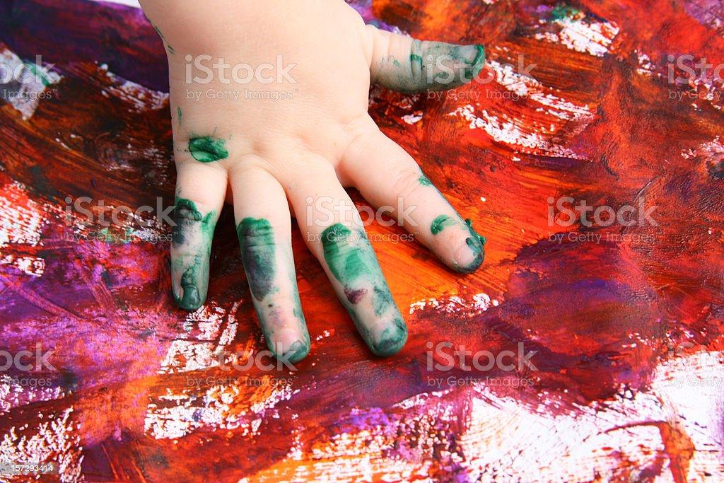 Handprint Art: Preschooler Finger painting stock photo