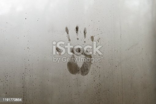 Handprint Impression on Steamy Glass Window