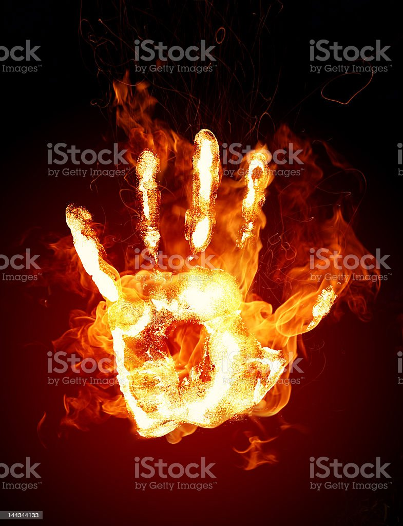 A handprint made of fire and flames stock photo