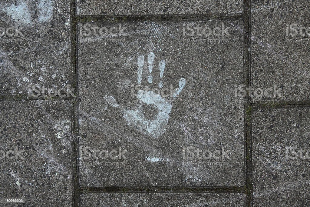 Handprint on te pavement from the children playing with chalk