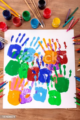 818533812 istock photo Handprints and art equipment 157639374
