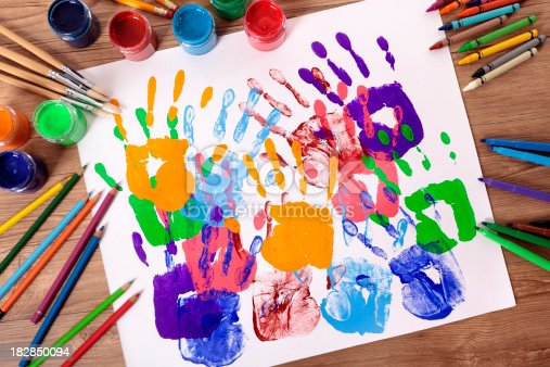 818533812 istock photo Handprints and art equipment 182850094