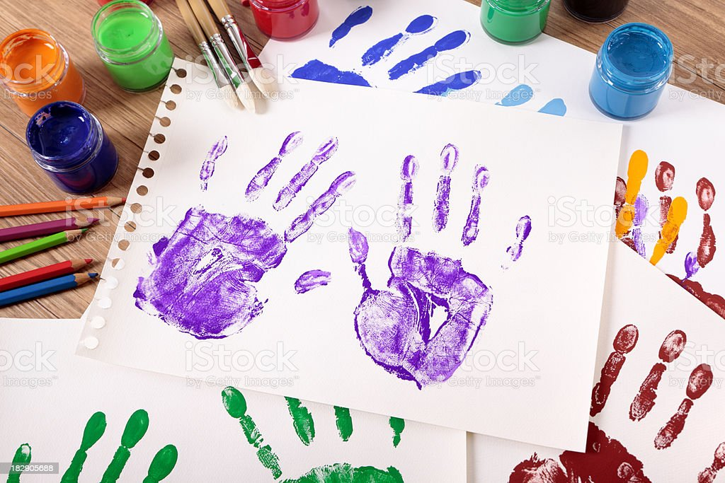 Handprints and art equipment royalty-free stock photo