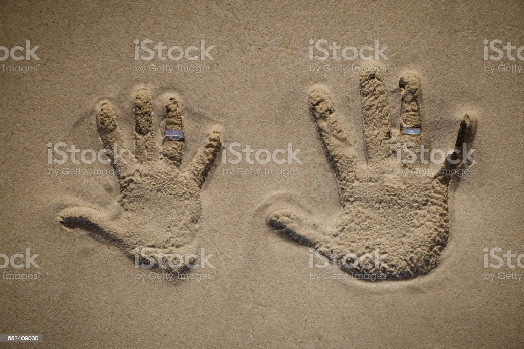 Hand-prints in the sand royalty-free stock photo