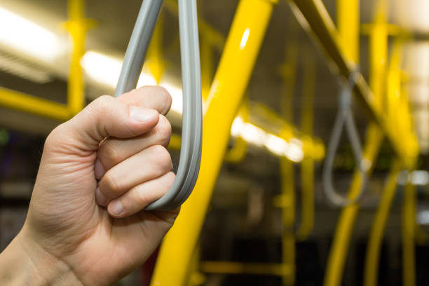 handrails in public transport. - hand grip stock photos and pictures