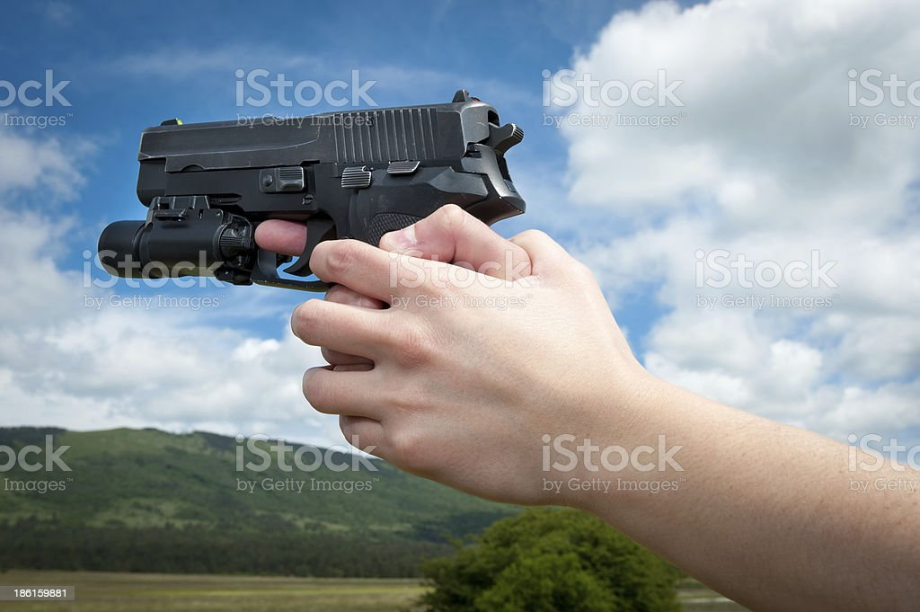 Hands aiming a gun in the distance royalty-free stock photo