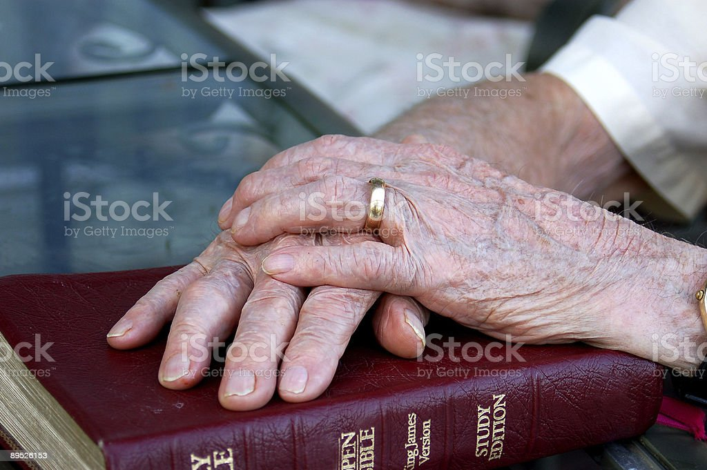 Hands and Bible stock photo
