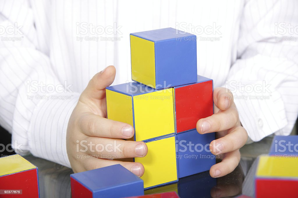 Hands and color bricks royalty-free stock photo