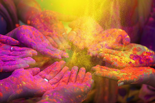 Hands of indian people during holi celebration in India