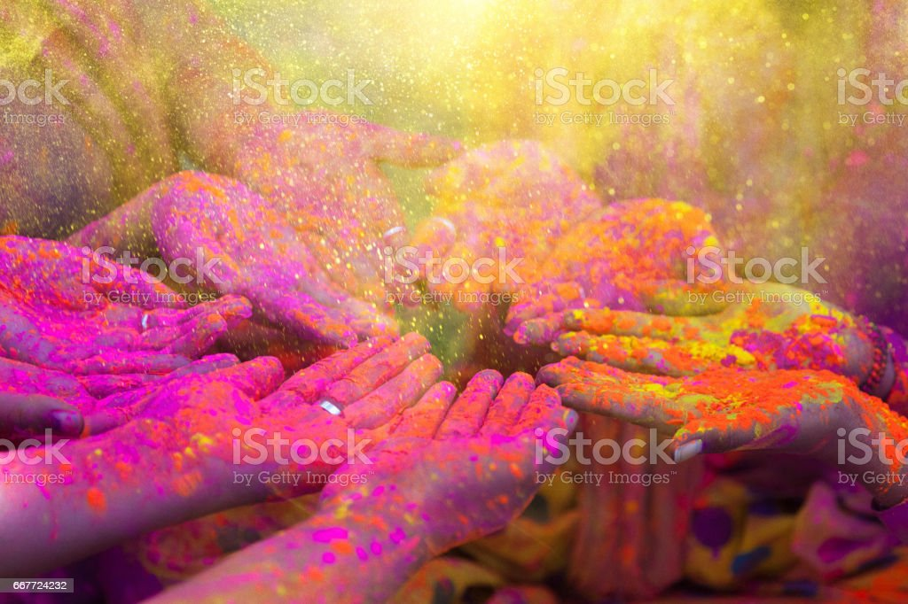 Hands and colorful powders of the holi festival stock photo