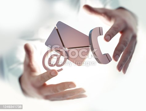 Hands with three communication symbols, Close-up Of Phone, Email and Post Icons