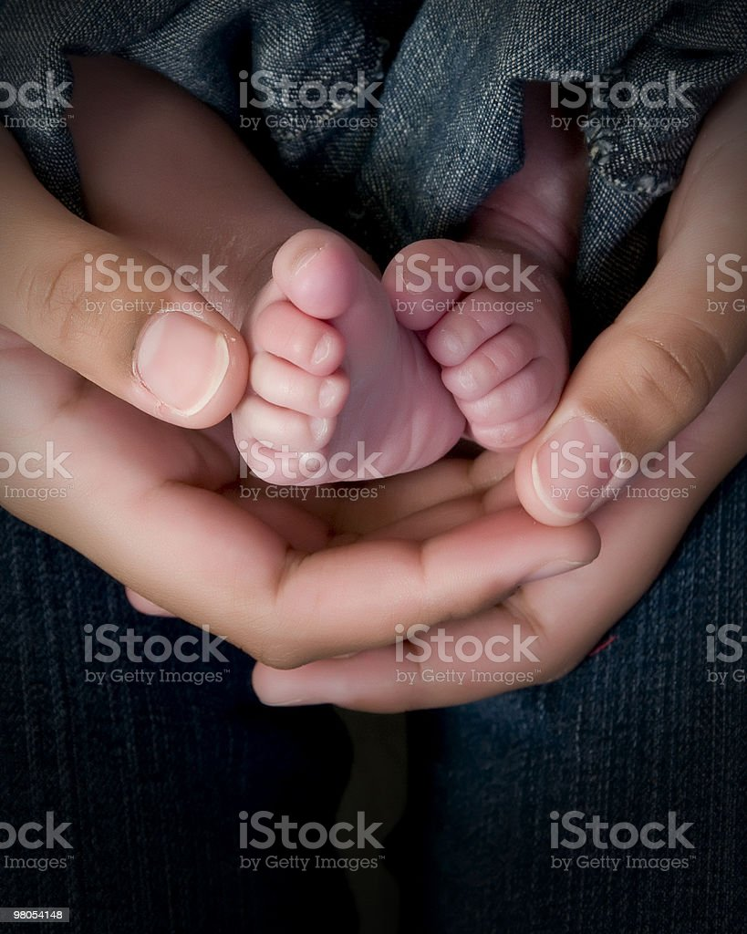 hands and feet in jeans royalty-free stock photo