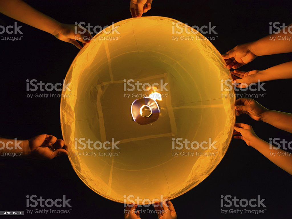 hands and firework for Loi Krathong Festival in Thailand stock photo
