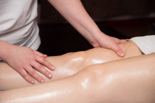 Hands and legs massage stock photo