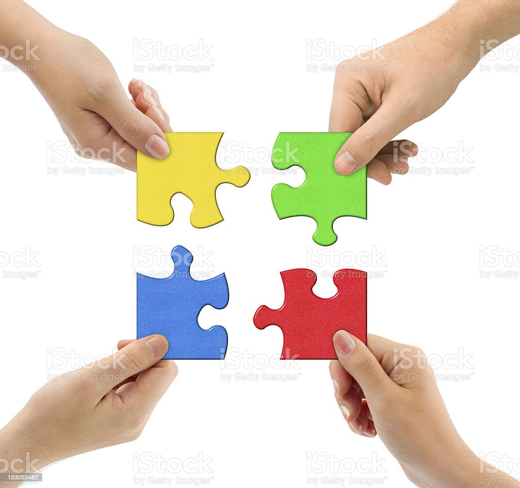 Hands and puzzle stock photo