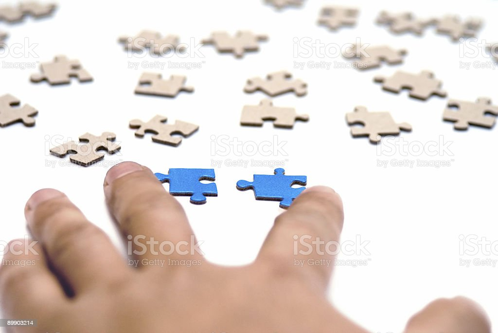 Hands and puzzle. royalty-free stock photo