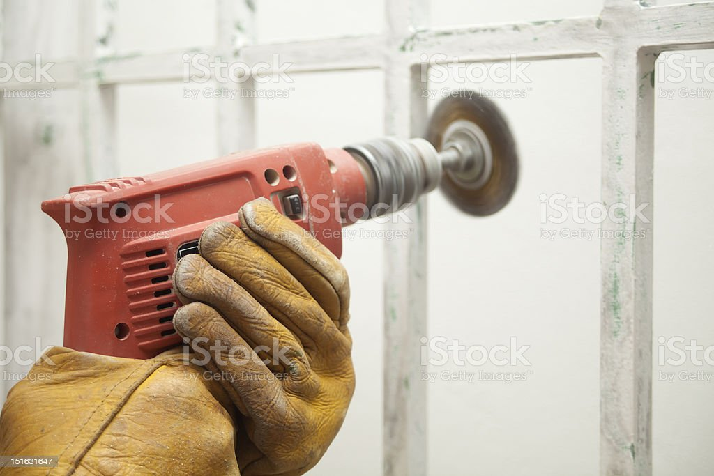 Hands and sander stock photo