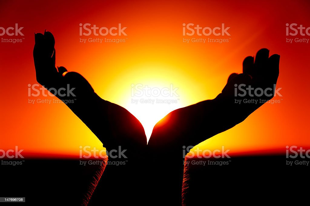 Hands and the Rising Sun stock photo