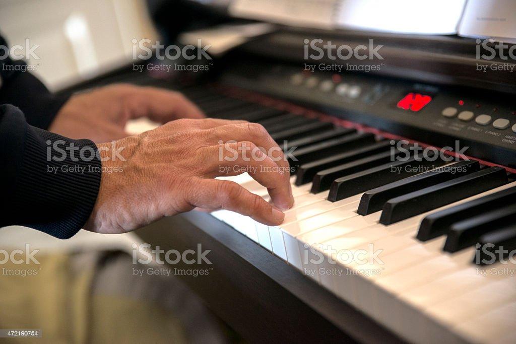Hands at piano stock photo