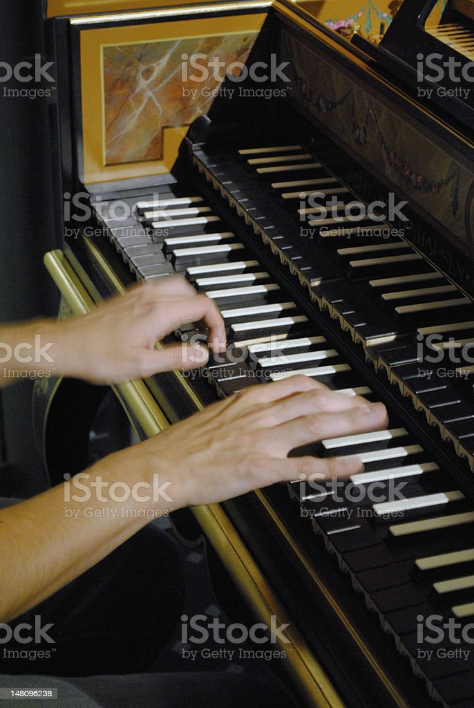 Hands at the harpsichord stock photo
