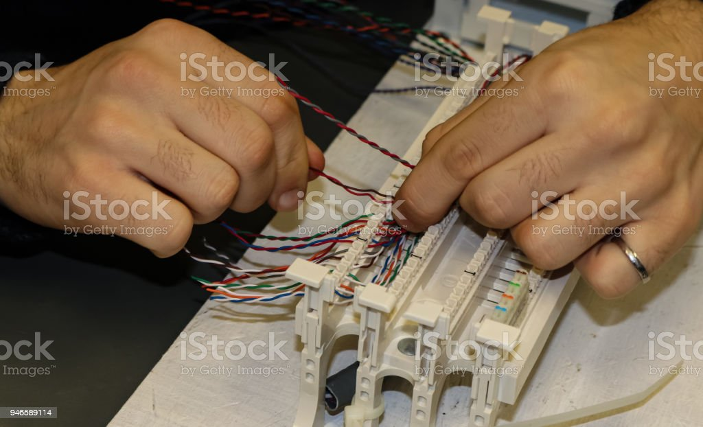 Hands at work in network cabling practice in an information technology classroom stock photo