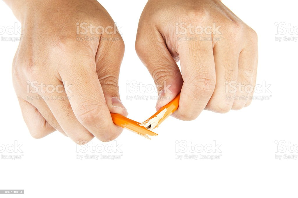 Hands Breaking a Pencil stock photo