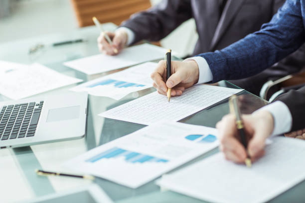 hands business team that works with financial schemes - foto de stock