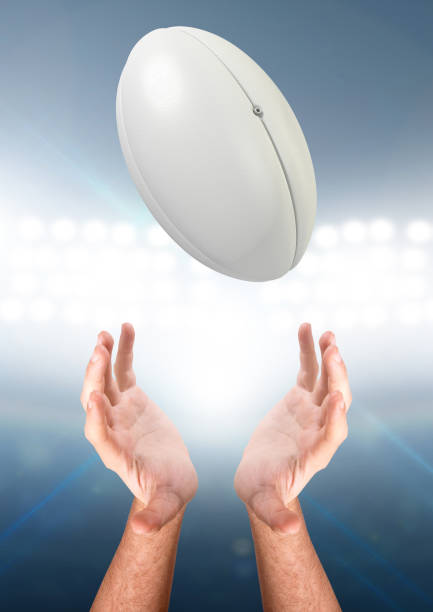 hands catching rugby ball - rugby ball stock photos and pictures