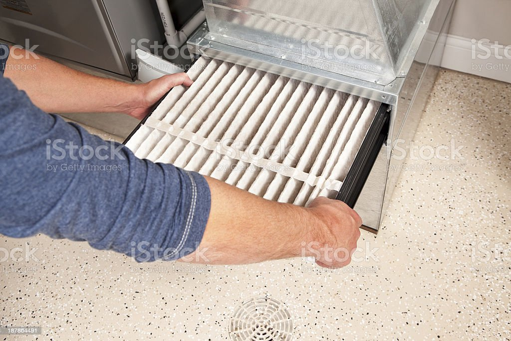 Hands Changing Furnace Air Filter stock photo