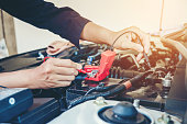 istock Hands check battery car mechanic working in auto repair service 889226026