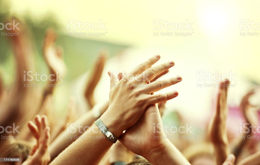 Hands Clapping in Crown Outdoors royalty-free stock photo