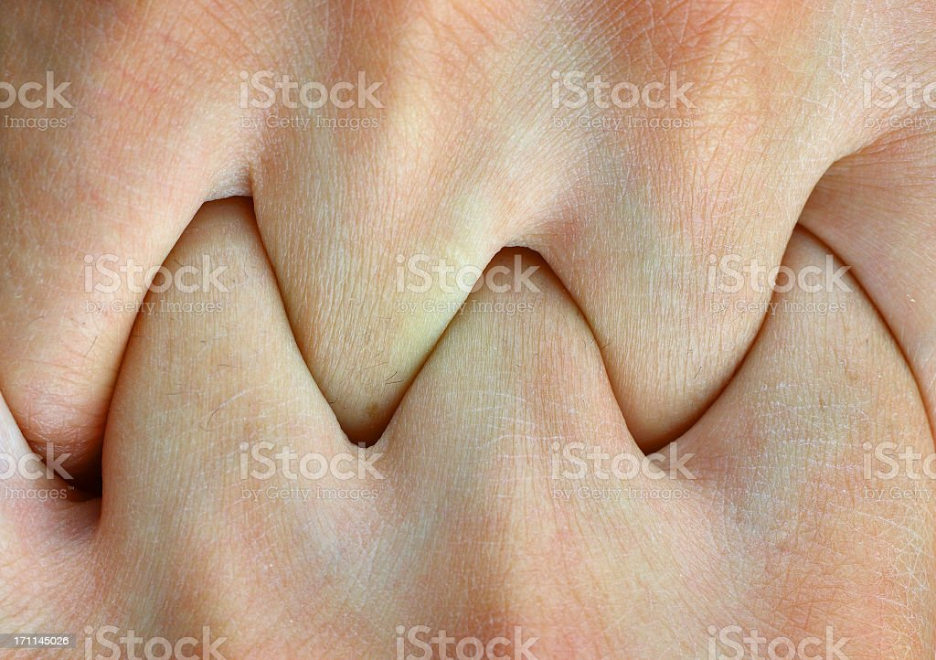Hands clasped stock photo