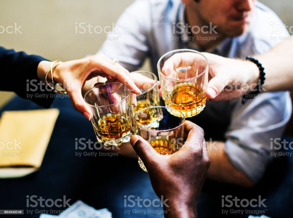 Hands clinging alcohol drink glasses stock photo
